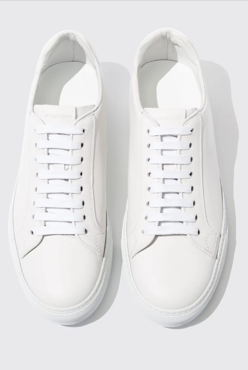 white leather lace up trainers